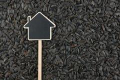 Alloggi il puntatore, le bugie del prezzo da pagare sul seme di girasole Fotografie Stock
