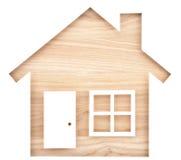 Alloggi il ritaglio di carta a forma di su legname di legno naturale Fotografie Stock