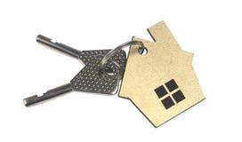 Alloggi la catena chiave a forma di isolata su fondo bianco Fotografia Stock