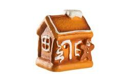 Alloggi la decorazione di natale e l'uomo di pan di zenzero isolati su bianco Immagine Stock Libera da Diritti