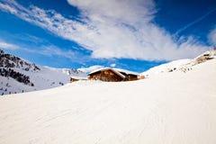 Alloggi in montagne delle alpi Immagine Stock Libera da Diritti