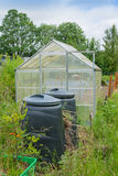 Allotment garden green house with compost bins Royalty Free Stock Images