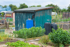 Allotment shed with compost bins and water butt Royalty Free Stock Photos