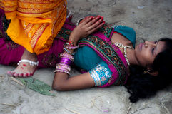 Allow me under your feet. Female devotees performing rituals during Chhath puja In India. It is the festival which is dedicated to the Sun god Royalty Free Stock Photography