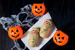 Нalloween treat sausage in the dough Stock Images