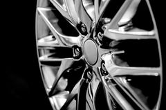 Alloy wheel as an automotive background Royalty Free Stock Photography