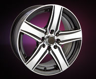 Alloy wheel. Or car rim in colored background royalty free stock image