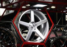Alloy Wheel of car on the shelf with red Hexagon frame. Alloy wheels are wheels that are made from an alloy of aluminium or magnesium. Alloys are mixtures of a stock photo