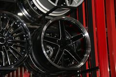 Alloy Wheel of car on the shelf. Alloy wheels are wheels that are made from an alloy of aluminium or magnesium. Alloys are mixtures of a metal and other royalty free stock image