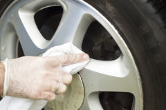 Alloy wheel cleaning with white cloth and cloth. Cleaning and regeneration of the alloy rims Stock Images
