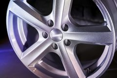 Alloy wheel on dark background Royalty Free Stock Photo
