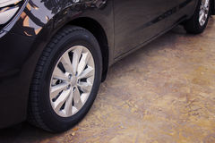 Alloy wheel of luxury car. Alloy wheel of black color luxury car in view side Stock Images