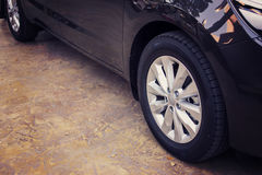 Alloy wheel of luxury car in view side. Royalty Free Stock Images