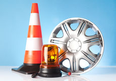 Alloy wheel with road emergency items Royalty Free Stock Image