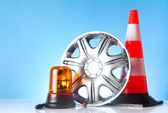 Alloy wheel with road emergency items Stock Photography