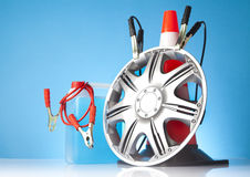 Alloy wheel with road emergency items Royalty Free Stock Photo