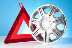 Alloy wheel with warning triangle Stock Photos