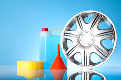 Alloy wheel with windshield washer fluid Royalty Free Stock Photo