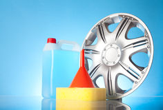 Alloy wheel with windshield washer fluid Stock Photography