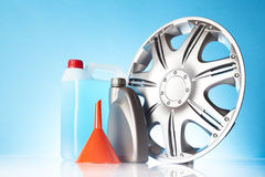 Alloy wheel with windshield washer fluid Royalty Free Stock Photos