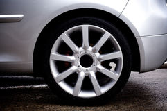 Alloy Wheels. On silver car royalty free stock photo