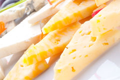 Allsorts from different grades of cheese. Canape Stock Photo