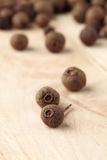Allspice. Closeup of allspice on a wooden table. Shallow dof, selective focus royalty free stock image
