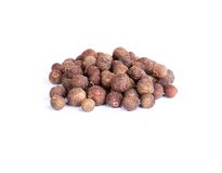 Allspice. Pile of dried allspice isolated on white background stock images