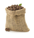 Allspice in bag on white Royalty Free Stock Photo