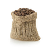 Allspice in bag on white. Background stock photos