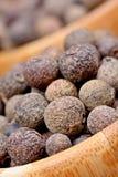 Allspice in a bamboo bowls. Closeup royalty free stock photo