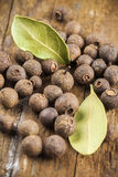 Allspice and bay leaf arrangement Royalty Free Stock Image