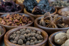 Allspice Berries Among Other Spices. In small brown bowls stock photography