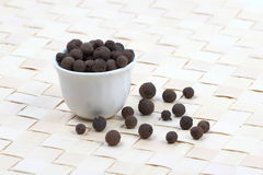 Allspice berries in a white pot Royalty Free Stock Photos