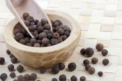 Allspice berries in a wooden pot Royalty Free Stock Photography