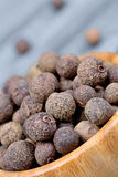 Allspice in a bowl on table. Allspice in a bowl on wooden table stock photos