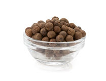 Allspice in bowl on white Stock Images