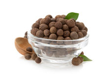 Allspice in bowl on white. Allspice in bowl isolated on white background Stock Photo