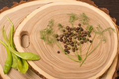 Allspice, dill and salad on wooden cutting. Background stock photos