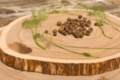 Allspice, dill and salad on wooden cutting. Background royalty free stock images