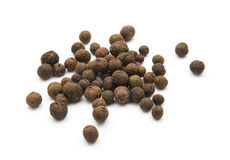 Allspice. Grains of allspice isolated on white background royalty free stock photos