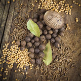 Allspice, nutmeg, mustard and bay leaf Stock Photo