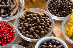 Allspice and other spices. On a wooden surface stock images