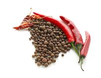 Allspice pepper with chili on white background royalty free stock images