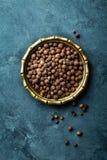 Allspice pepper, peppercorns on dark culinary background, top view stock photo