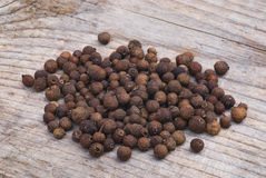 Allspice (Pimenta dioica). Pile of Allspice, also called Jamaica pepper or pimento Royalty Free Stock Images
