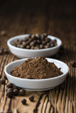 Allspice Powder. (close-up shot) on rustic wooden background royalty free stock photos