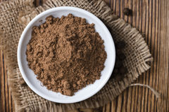 Allspice Powder. (close-up shot) on rustic wooden background royalty free stock image
