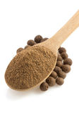 Allspice powder and wooden spoon royalty free stock images