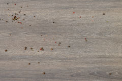 Allspice scattered on wooden table. Useful as food background royalty free stock photography